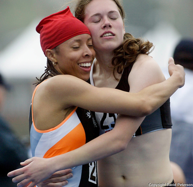 Linise Gordon, left, and Barbara Szlendakova embrace after the end of the 800 meters in the Drake Relays heptathlon won by Gordon. The annual Drake Relays, one of America's premier track and Field events, is held over the last weekend of April.  Szlendakova was second in the seven event final held in Des Moines, Iowa, USA.