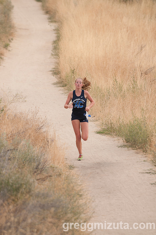Mountain View junior Sam McKinnon has separated from the rest of the field as she leads during the 2011 Camelsback Invitational at Boise, ID on August 27, 2011. McKinnon finished first (19:32) and led   Mountain View to a win with a score of 21 over Rocky Mountain, Borah, Mountain Home, Emmett, and Payette.
