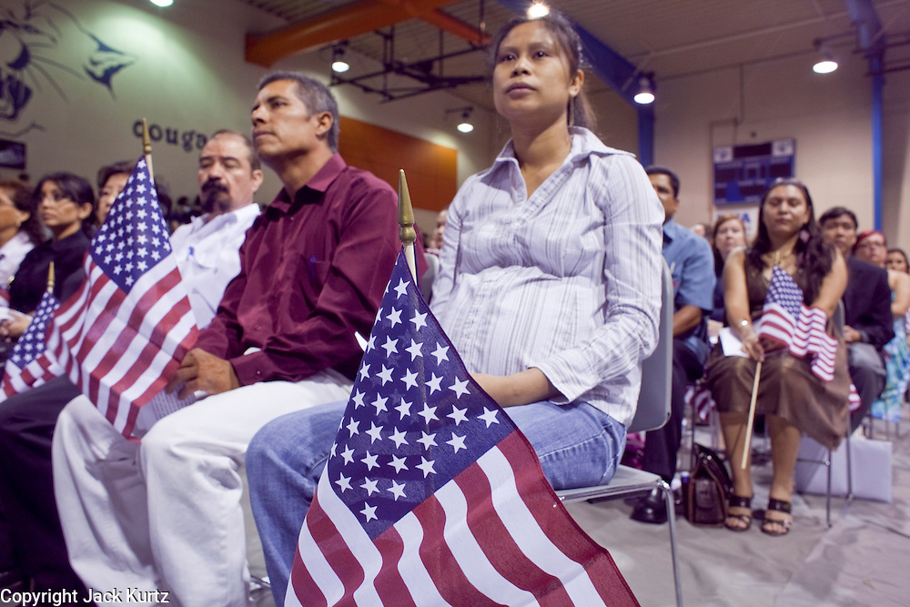"04 JULY 2009 -- PHOENIX, AZ:  A woman from Cambodia is sworn in as a new US citizen at a naturalization ceremony in Phoenix, AZ, July 4. U.S. Citizenship and Immigration Services and South Mountain Community College in Phoenix, AZ, hosted the 21st annual ""Fiesta of Independence"" Saturday, July 4. More than 180 people from 58 countries took the US Oath of Citizenship and became naturalized US citizens. The ceremony was one of dozens of similar ceremonies held across the US this week. USCIS said more than 6,000 people were naturalized US citizens during the week.  Photo by Jack Kurtz / ZUMA Press"