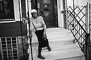 """Luzanna """"Miss Luchie"""" Campbell, 90, has lived on Kossoth Place in Bushwick since she was 18 and has watched the neighborhood change. Now, all the German immigrants have moved away. After attending five different universities and trade school, Miss Lucie speaks (or tries) Spanish to many of the Puerto Ricans who pass her door."""