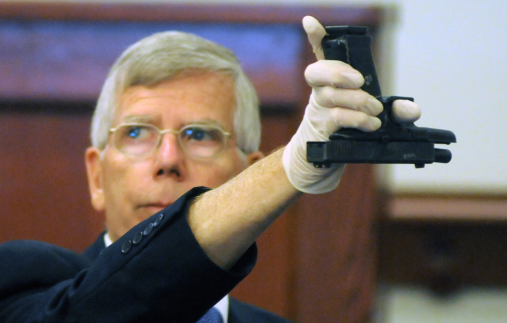 apl070313i/ASECTION/Pierre-Louis/Albuquerque Journal/070313 <br /> Crime Scene expert  Larry McCann, shows the jury  how Tera Chavez, shot herself using her husband Levi Chavez,,  APD issued Glock handgun upside down during testimony  on Wednesday July 3, 2013.Mc .  (Adolphe Pierre-Louis-Journal)