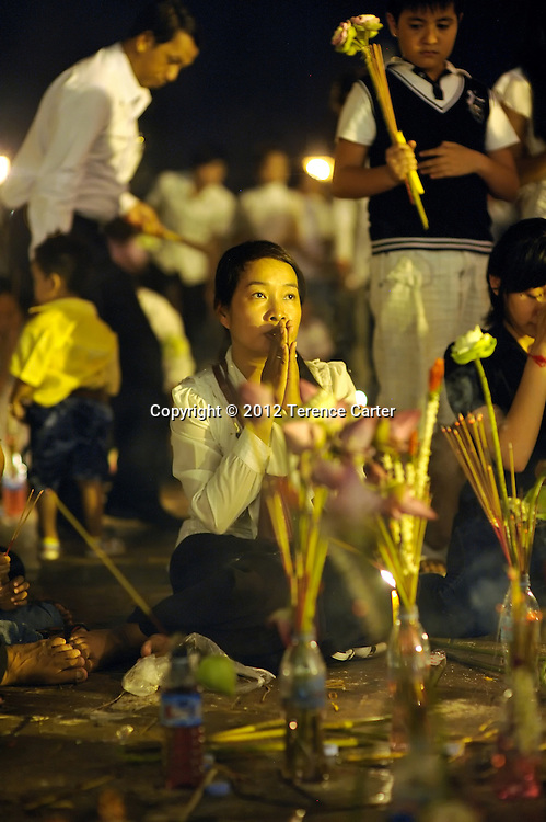 A mourner prays outside the Royal Palace after King Father Norodom Sihanouk's body was returned to Phnom Penh, starting a week of mourning.
