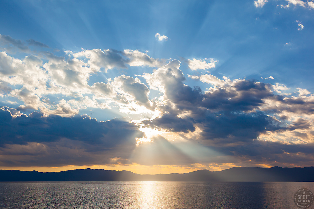 """Crepuscular Rays Over Lake Tahoe 1"" - These crepuscular rays were photographed near sunrise over Lake Tahoe. Shot from a small fishing boat during the annual Jakes on the Lake charity fishing derby."