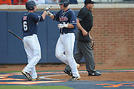 Mississippi's Taylor Hashman (27) drives in Mississippi's Miles Hamblin (24) vs. Virginia during an NCAA Regional game at Davenport Field in Charlottesville, Va. on Saturday, June 5, 2010.