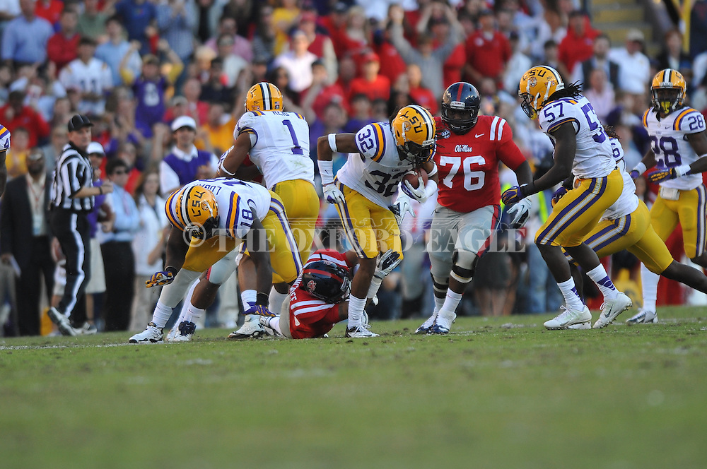 LSU cornerback Jalen Collins (32) receives a block from LSU defensive tackle Bennie Logan (18) as he intercepts against Ole Miss wide receiver Donte Moncrief (12) at Tiger Stadium in Baton Rouge, La. on Saturday, November 17, 2012.....