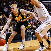 WEST LAFAYETTE, IN - JANUARY 27: Aaron White #30 of the Iowa Hawkeyes dribbles to the baseline as D.J. Byrd #21 of the Purdue Boilermakers defends at Mackey Arena on January 27, 2013 in West Lafayette, Indiana. Purdue defeated Iowa 65-62 in overtime. (Photo by Michael Hickey/Getty Images) *** Local Caption *** Aaron White; D.J. Byrd
