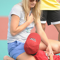 Kat Villarreal and her daughter Alexa Villarreal observe the National Anthem Saturday September 13, 2014 during the opening weekend of The Miracle League. (Jason A. Frizzelle)