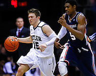 INDIANAPOLIS, IN - FEBRUARY 19: Rotnei Clarke #15 of the Butler Bulldogs brings the ball up court during the game as Jerry Jones #5 of the Duquesne Dukes defends at Hinkle Fieldhouse on February 19, 2013 in Indianapolis, Indiana. Butler defeated Duquesne 68-49. (Photo by Michael Hickey/Getty Images) *** Local Caption *** Rotnei Clarke; Jerry Jones