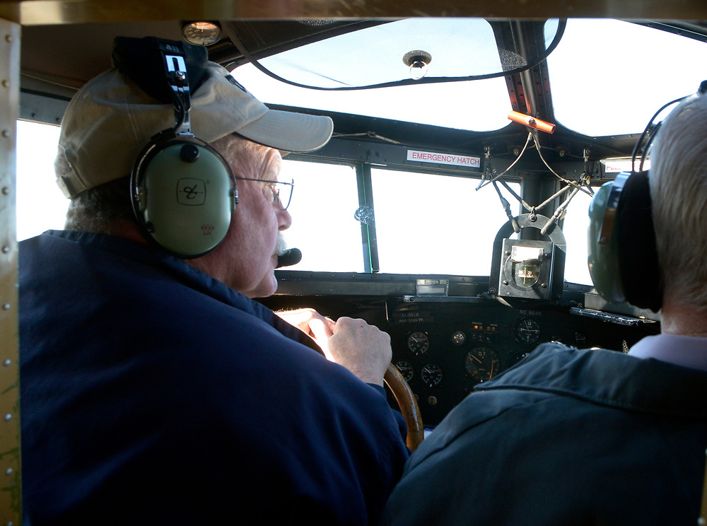 gbs040617g/RIO-WEST -- Ed Rusch of Port Clinton, Ohio, left,  pilots a 1928 Ford Tri-Motor at the Double Eagle II Airport on Thursday, April 6, 2017. (Greg Sorber/Albuquerque Journal)