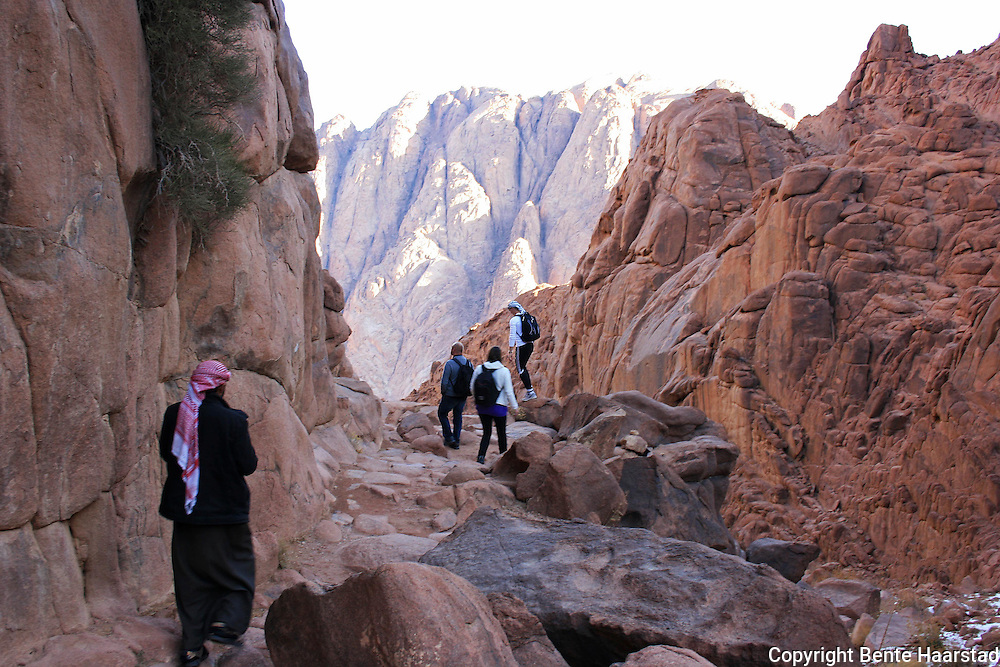 """Every visitor or group of visitors to Mt. Sinai has to have a beduin guide. Guides are provided by the tribal rotating system. Jebel Musa is Arabic for """"the mountain of Moses."""" The mountain is ascended by 3700 steps carved by a monk (the """"steps of repentance""""). The path leads past the """"Spring of Moses"""" and a chapel dedicated to the Virgin Mary. Closer to the summit is the """"Spring of Elijah""""."""