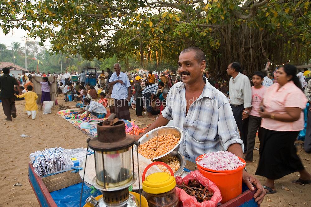 Gram seller at the kovil festival. Batticaloa. East Coast,