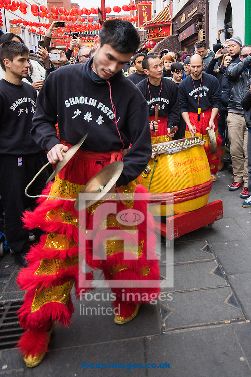 Drums and cymbals accompany the dragon from restaurant to restaurant as Thousands of Londoners help the capital&rsquo;s Chinese population celebrate their new year, The Year of The Monkey in Chinatown, London.<br /> Picture by Paul Davey/Focus Images Ltd +447966 016296<br /> 14/02/2016