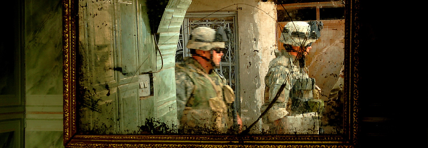 August 7, 2006: Soldiers from Bravo Company, 2-6 Infantry, Task Force 1-35 Armored Division, Baumholder, GE leave an Iraqi family's home after questioning them and filling out a census in Tameem, Ramadi, Iraq. The census is geared to finding out general information on the Iraqi household and to see if they have any concerns or questions they can help with. The mission is part of the continuing support of the 1-1 Armored Division.  1-1AD is deployed with I Marine Expeditionary Force (Forward) in support of Operation Iraqi Freedom in the Al Anbar province of Iraq (Multi National Forces-West) to develop the Iraqi security forces, facilitate the development of official rule of law through democratic government reforms, and continue the development of a market based economy centered on Iraqi reconstruction. (U.S. Air Force photo by Tech Sergeant Jeremy T. Lock) (Released) | Jeremy Lock Photography