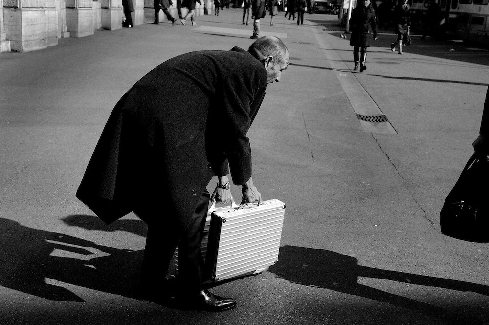 Man with metal suitcases on Paradeplatz, the symbolic heart of the Swiss banking industry. Switzerland's two largest banks, UBS and Credit Suisse have their headquarters on the this square in the centre of Zurich. The Swiss banking industry holds an estimated almost US$7000 billion , more than half of it foreign.