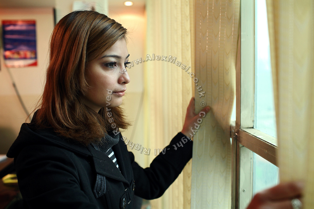 Somaya Rezaie, 20, a young Afghan actress whose career has been affected by having part of the movie where she acted subtracted and played along 'music clips', is gazing at the streets from the window of a friend's home in Kabul, Afghanistan. Women appearing on 'music clips' in Afghanistan can be seen as 'immoral' by the public, might face dangers while and their careers can also be at stake.