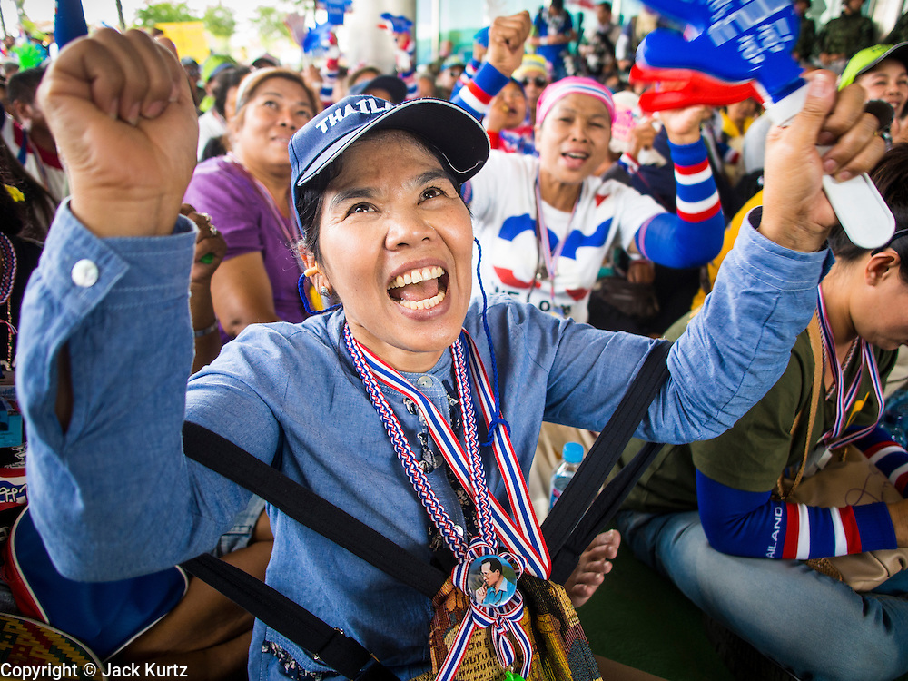 "08 APRIL 2014 - BANGKOK, THAILAND:  Anti-government protestors cheer for Suthep Thaugsuban while they block the entrance to the Ministry of Justice in Bangkok. Several hundred anti-government protestors led by Suthep Thaugsuban went to the Ministry of Justice in Bangkok Tuesday. Suthep and the protestors met with representatives of the Ministry of Justice and expressed their belief that Thai politics need to be reformed and that corruption needed to be ""seriously tackled."" The protestors returned to their main protest site in Lumpini Park in central Bangkok after the meeting.   PHOTO BY JACK KURTZ"