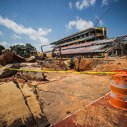 "Construction crews and engineers work toward a permanent fix for a 40-foot sinkhole that opened in the end zone of Governors Stadium during renovation construction on Tuesday, May 20, 2014.  Austin Peay's main campus quad area is highlighted by several large sinkholes, nicknamed ""the bowls."" These bowls are popular hangouts for studying, lounging, frisbee games or student activities. (Taylor Slifko, APSU)"
