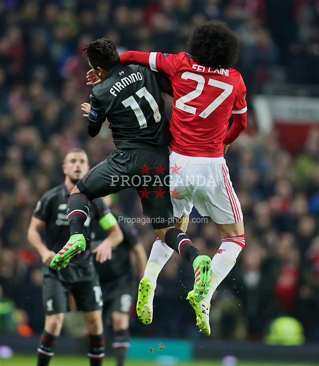 MANCHESTER, ENGLAND - Wednesday, March 16, 2016: Liverpool's Roberto Firmino gets an elbow in the face from Manchester United's Marouane Fellaini, who typically wasn't' booked, during the UEFA Europa League Round of 16 2nd Leg match at Old Trafford. (Pic by David Rawcliffe/Propaganda)