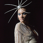 Deonna Pinkerton shows off a white dress and exotic headwear during the Ebony Fashion Fair held at Mahaffey Theater. Proceeds from the Fashion Fair, which is in it's 50th year, benefit charities.