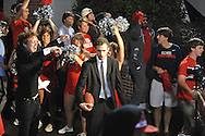 """Patrick Haadsma (right) and Blake Pruett act during filming of a new """"Feed Moncrief"""" video at Vaught-Hemingway Stadium in Oxford, Miss. on Thursday, December 6, 2012."""