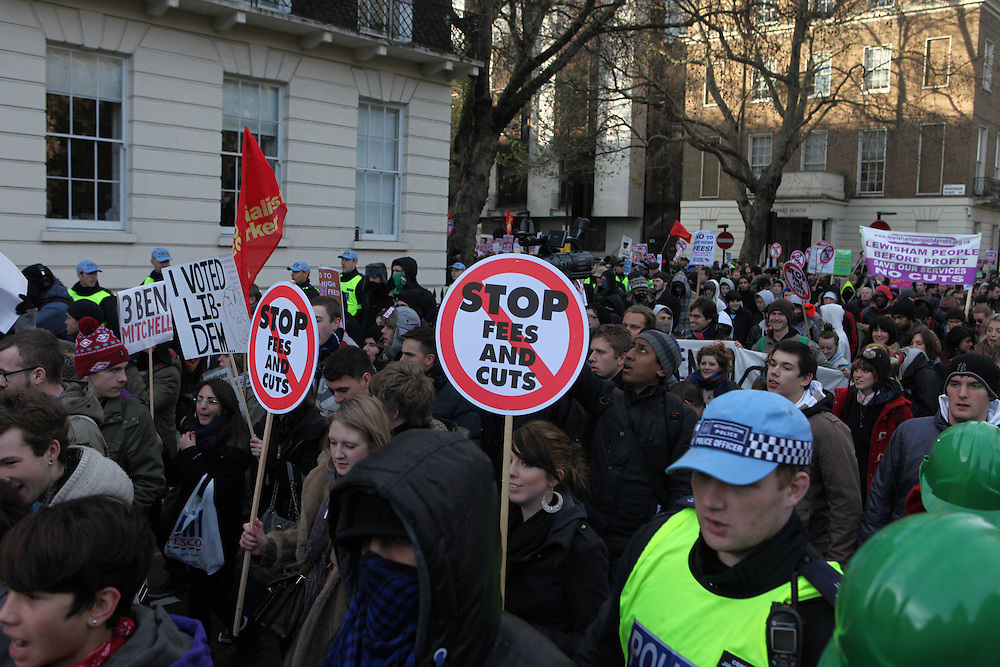 """For weeks now, Britain's students have been protesting a proposal from the new Conservative-led government that aims to triple tuition fees for university students. On 9 December, as the proposal went to vote in the parliament, tens of thousands of students marched a few miles from the University of London Union to just a couple hundred meters from parliament where they """"kettled"""" (encircled) by police. While protestors argued with officers and burned bonfires to stay warm in the near freezing temperatures, parliamentarians passed the plan to raise tuitions by a majority of 21 votes."""