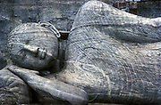 The Gal Vihara at Polonnaruwa. Close up of the reclining figure of the Buddha. Polonnaruwa is A UNESCO World Heritage Site