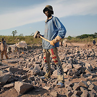 A worker in a quarry near Brazzaville, Congo, 2007.<br /> <br /> Allthough the main quarry was operated by a  multinational corporation with the most modern technology, there is room for local interests to pursue exploration with more &quot;traditional&quot; methods.