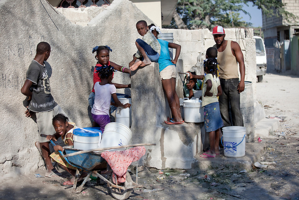 People gather round a watering hole in Anse a Galet, Ile de la Gonave, Haiti