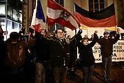 Frankfurt am Main | 09 Feb 2015<br /> <br /> Am Montag (09.02.2015) demonstrierte bereits zum dritten Mal die islamfeindliche und rassistische Gruppierung PEGIDA (Patrioden gegen die Islamisierung des Abendlandes) unter F&uuml;hrung der Frankfurterin Heidi Mund und in Gegenwart des Neonazis und Vorsitzenden der NPD Hessen, Stefan Jagsch, an der Katharinenkirche in Frankfurt am Main, PEGIDA konnte etwa 100 Demonstranten mobilisieren. An den Gegendemos nahmen etwa 1000 Menschen teil.<br /> Hier: PEGIDA-Aktivisten halten sich an den H&auml;nden und &quot;sp&uuml;ren die Energie&quot;.<br /> <br /> &copy;peter-juelich.com<br /> <br /> [No Model Release | No Property Release]