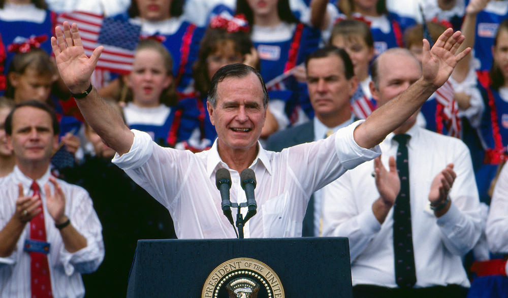 A rain-soaked President George H.W. Bush campaigns for a second four year term as President of the United States in Woodstock, Georgia.  Bush was unsuccessful in his bid, losing to Bill Clinton.