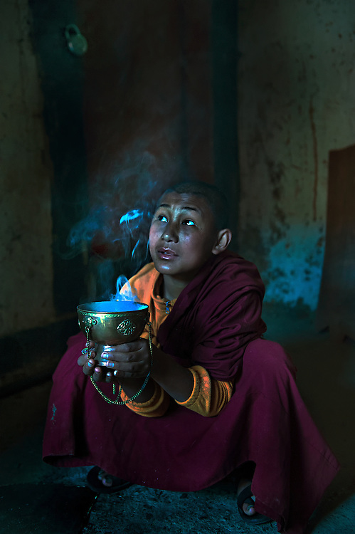 A monk prepares for a ceremony at the Black Hat festival in Bumthang, Bhutan.