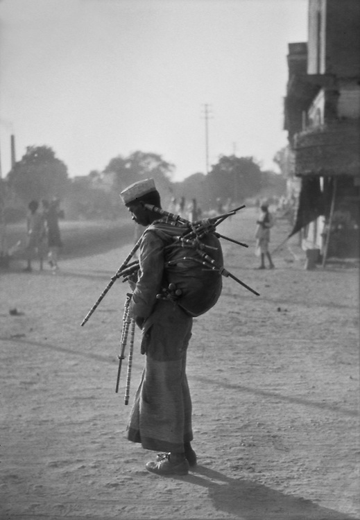 A hookah seller standing on the street, 1929