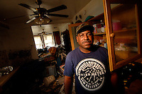 """""""I live here with me, my wife, my 2 daughters, my 2 sons, and 6 grandchildren. I evacuated from Austin, TX, Dallis, TX, Columbia, Miss, and back to New Orleans where I will rebuild my house and will stay.""""  .Resident of the lower 9th Ward in New Orleans, Lawrence Hamilton's, home was destroyed by floodwaters following Hurricane Katrina two months prior."""