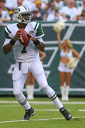 EAST RUTHERFORD, NJ - SEPTEMBER 7: Geno Smith (7) of the New York Jets looks to pass during a game against the Oakland Raiders at MetLife Stadium on September 7, 2012 in East Rutherford, NJ.  (Photo by Ed Mulholland/Getty Images)
