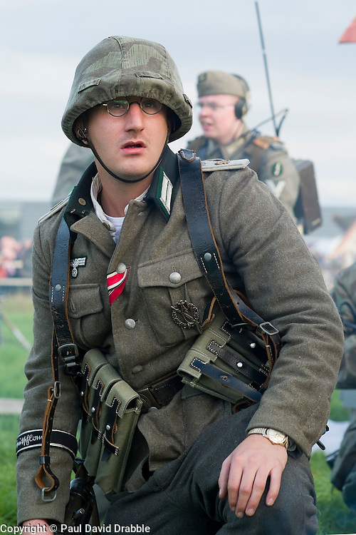 A Re-enactor portraying a  lieutenant in from Panzer Grenadier Division Grossdeutschland takes part in a battle battle re-enactment on Pickering Showground during the Pickering War Weekend<br /> <br /> 17/18 October 2015<br />  Image &copy; Paul David Drabble <br />  www.pauldaviddrabble.co.uk