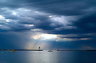 Storm clouds over the Grand Marais Harbor on the North Shore of Lake Superior in Minnesota. ..