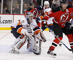 November 16, 2007; Newark, NJ, USA;  New Jersey Devils center Dainius Zubrus (16) tries to screen New York Islanders goalie Rick DiPietro (39) during the second period at the Prudential Center in Newark, NJ.