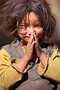 A young girl welcomes weary trekkers to her village of Dhakmar in the Mustang Region of Northern Nepal.