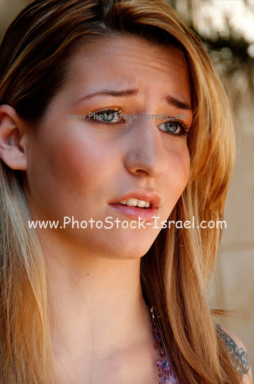 A disappointed young blond teen model