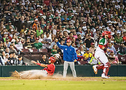 CULIACAN, MEXICO - FEBRUARY 7, 2017: Yadiel Rivera #13 of Puerto Rico slides safely home and scores the game winning run in the top of the tenth inning after teammate Jonathan Morales #29 hits a sacrifice fly during the Caribbean Series championship game against Mexico at Estadio de los Tomateros on February 8, 2017 in Culiacan, Rosales. (Photo by Jean Fruth)