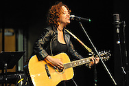 Lynn Drury plays guitar at Peach Jam, a celebration of female poets and musicians, at the Powerhouse in Oxford, Miss. on Wednesday, March 26, 2014.