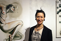 Lisa Roggenbuck next to her painting, &quot;Real Women Run with Scissors&quot; (2015, <br /> oil paint on stretched canvas 61&quot; x 44&quot;) at the Visual Art Collective. Jodi Eichelberger's ST(r)EAM Artist Studio/Gallery bike tour in the Surel Mitchell Live-Work-Create District in Garden City, Idaho on June 18, 2016.<br /> <br /> Tour started at the studios of Susan Madacsi, April VanDeGrift, Erin Cunningham, and continued to Ken McCall Studios, James &amp; Matt Wilson of Red Valley Mandolins, Arin Arthur, Angie Bowling Sebolt, Belinda Isley, Matt Herberg, Lisa Roggenbuck and the Visual Arts Collective.