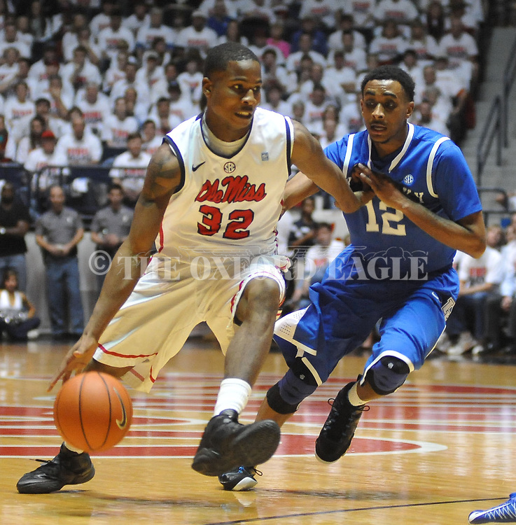 "Mississippi's Jarvis Summers (32) drives against Kentucky's Ryan Harrow (12) at the C.M. ""Tad"" Smith Coliseum on Tuesday, January 29, 2013.  (AP Photo/Oxford Eagle, Bruce Newman).."