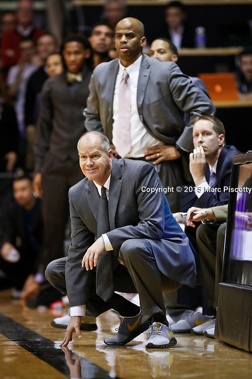 SHOT 1/22/15 10:15:49 PM - Colorado head basketball coach Tad Boyle watches his team play against Washington during their regular season Pac-12 basketball game at the Coors Events Center in Boulder, Co. Washington won the game 52-50 on a shot with less than a second to play in the game. (Photo by Marc Piscotty / © 2015)