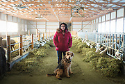 WESTBY, WI — DECEMBER 9: Brenda Jensen, owner of Hidden Springs Creamery, and her dog Gus pose for a portrait in the main sheep barn. Jensen and Hidden Springs Creamery have won numerous National and International awards for their sheep cheeses.