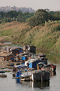 Floating boat houses on the Red River coming from many poor rural of Vietnam, seen from Long Bien Bridge, Hanoi, Vietnam