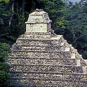"""At Palenque, Mexico, the Temple of the Inscriptions is the burial shrine of Maya leader Pacal the Great (615-683 AD). The name """"Pacal"""" means """"shield"""" in the Maya language. Published in Wilderness Travel 1987 Catalog of Adventures."""
