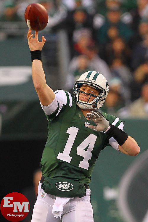 Dec 2, 2012; East Rutherford, NJ, USA; New York Jets quarterback Greg McElroy (14) throws a pass during the second half of their game against the Arizona Cardinals at MetLIfe Stadium. The Jets defeated the Cardinals 7-6.