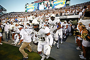 SHOT 9/19/15 6:54:04 PM - Colorado's Donovan Lee #29 retakes the field with teammates after halftime of  the Rocky Mountain Showdown against Colorado State at Sports Authority Field at Mile High in Denver, Co. Colorado won the game 27-24 in overtime. (Photo by Marc Piscotty / © 2015)