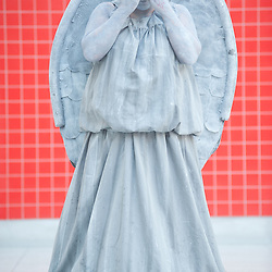 London, UK - 26 May 2013: Sarah Bending dressed as a weeping angel from doctor Who poses for a picture during the London Comic Con 2013 at Excel London. London Comic Con is the UK's largest event dedicated to pop culture attracting thousands of artists, celebrities and fans of comic books, animes and movie memorabilia.